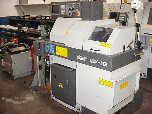 1/2 , STAR SH-12,FANUC 21-T,LNS BAR FEED,10,000 RPM,5 OD,3 ID, 1996